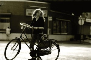 Patti Smith and her bicycle in the Meatpacking District, New York City, 1999. Photograph by Steven Sebring.